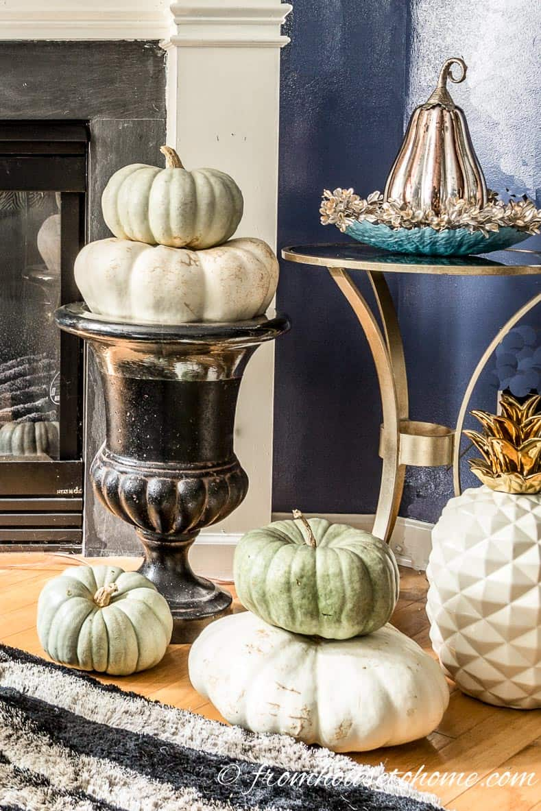 Teal and white heirloom pumpkins as living room fall home decor