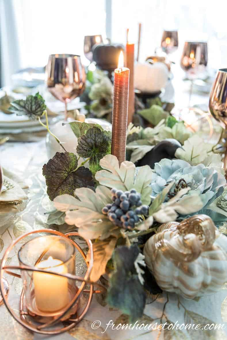 Copper candles in a leafy fall table centerpiece