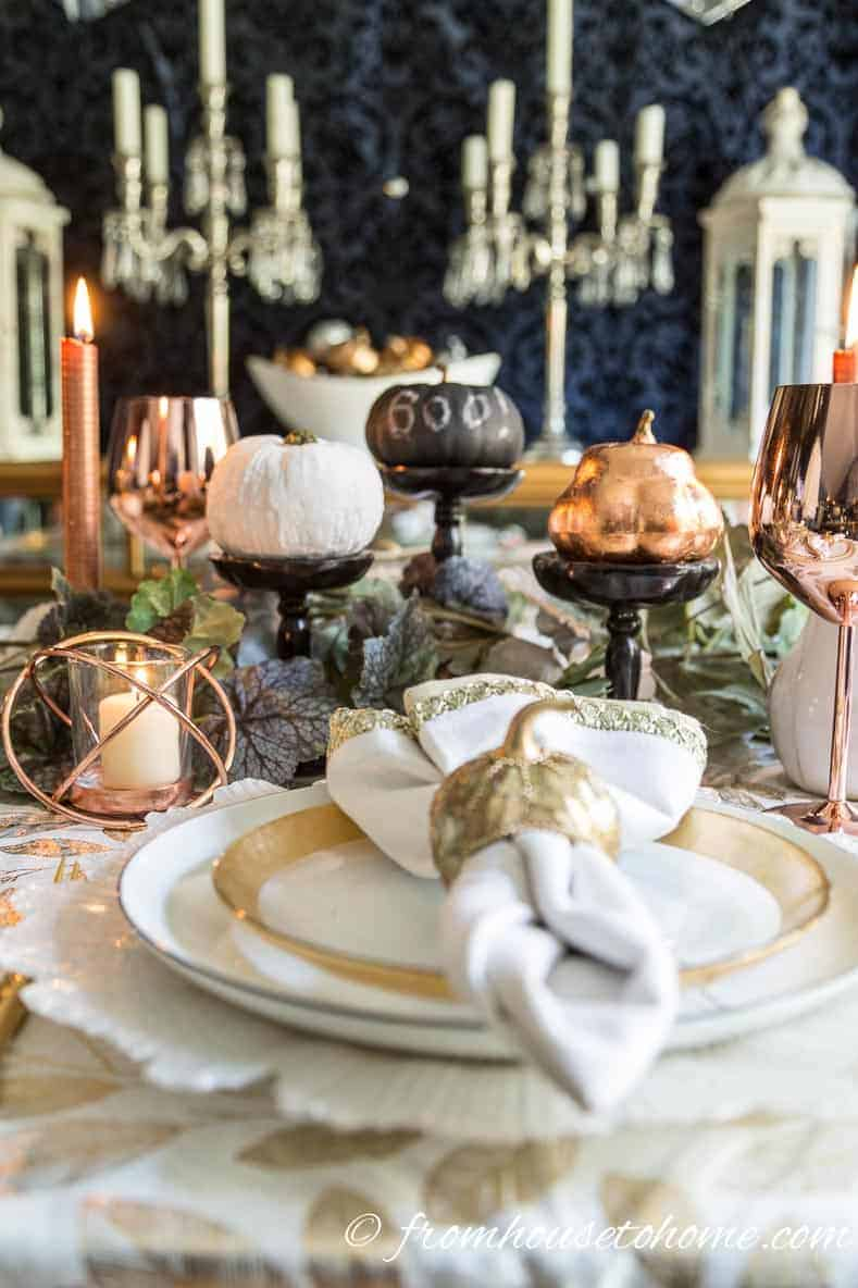Copper fall table with white, black and copper mini pumpkins in the centerpiece