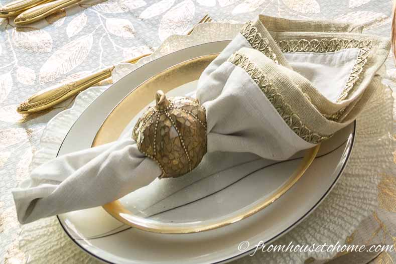 Copper pumpkin napkin ring on white and gold napkins