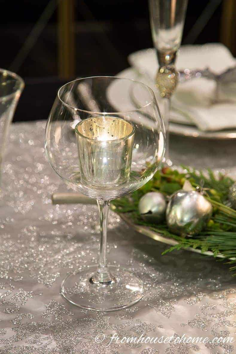 A Chardonnay wine glass used as a candle holder