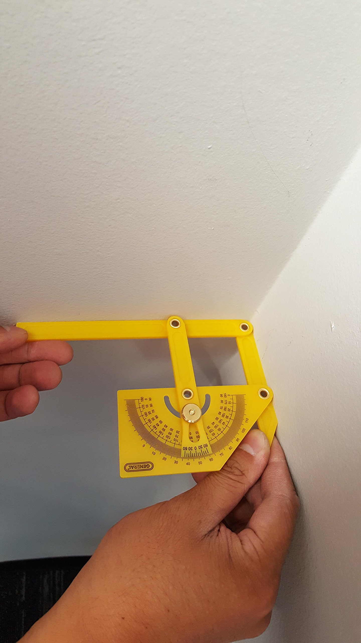 angle finder measuring the corner of a wall and ceiling