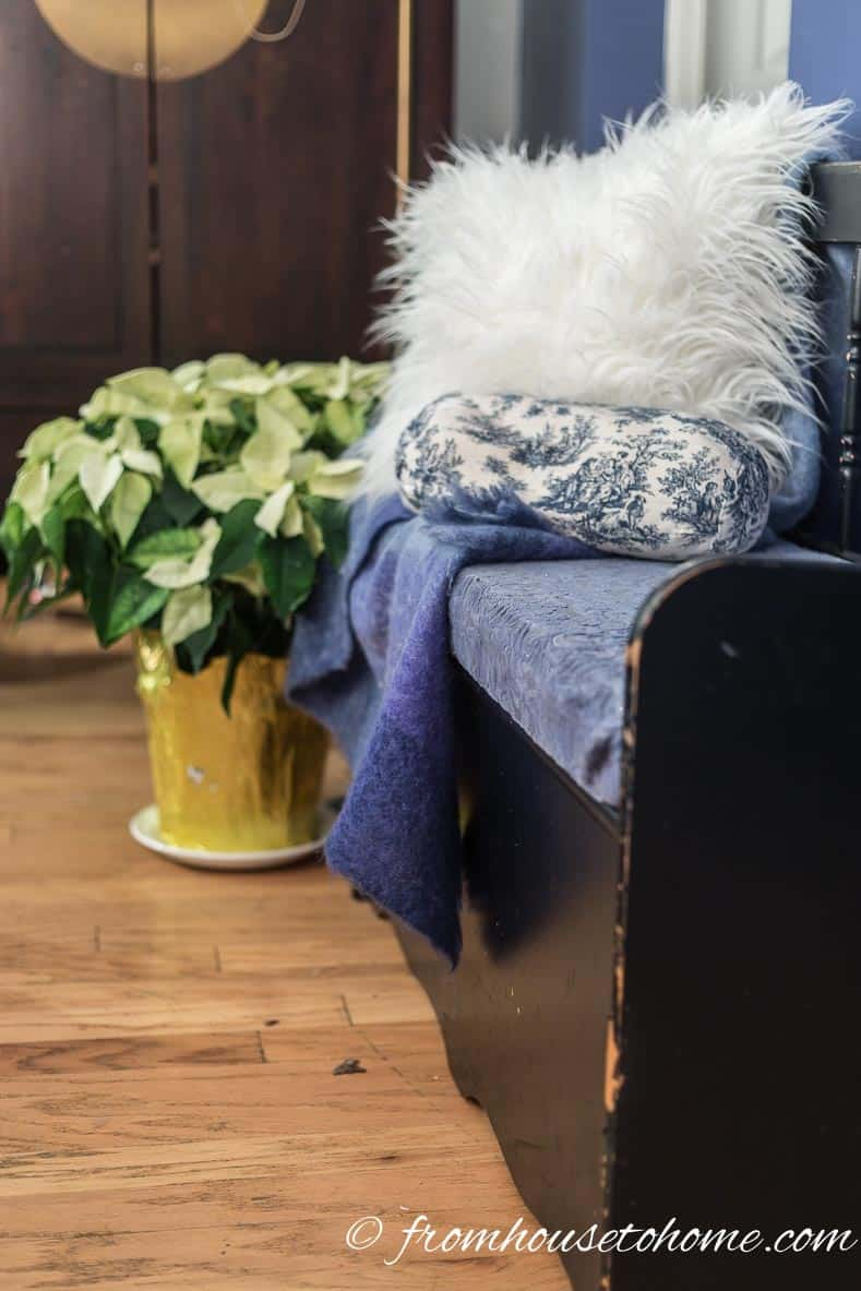 Faux fur cushion adds texture to the front hall bench | Blue and White Christmas Home Decorating Ideas