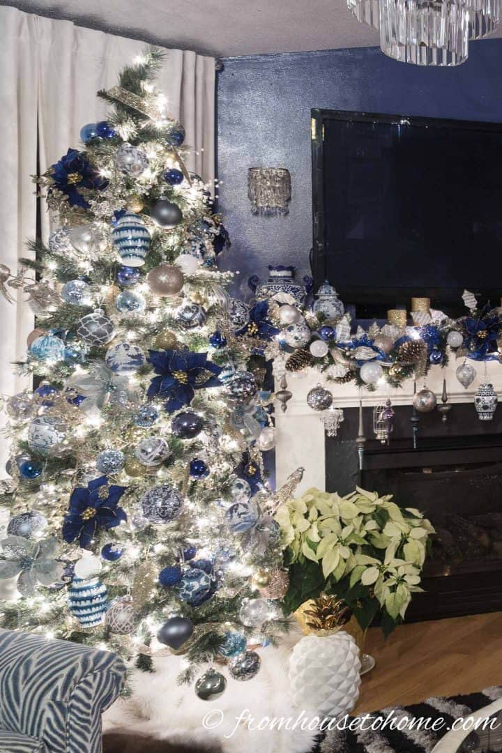 The tree is an extension of the garland on the mantel