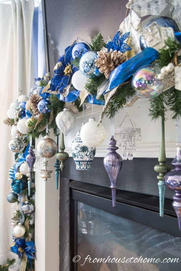 Christmas garland made with lots of blue, white and gold Christmas ornaments