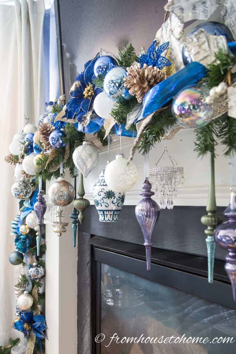 Ornaments make a statement on the fireplace mantel | Blue and White Christmas Home Decorating Ideas