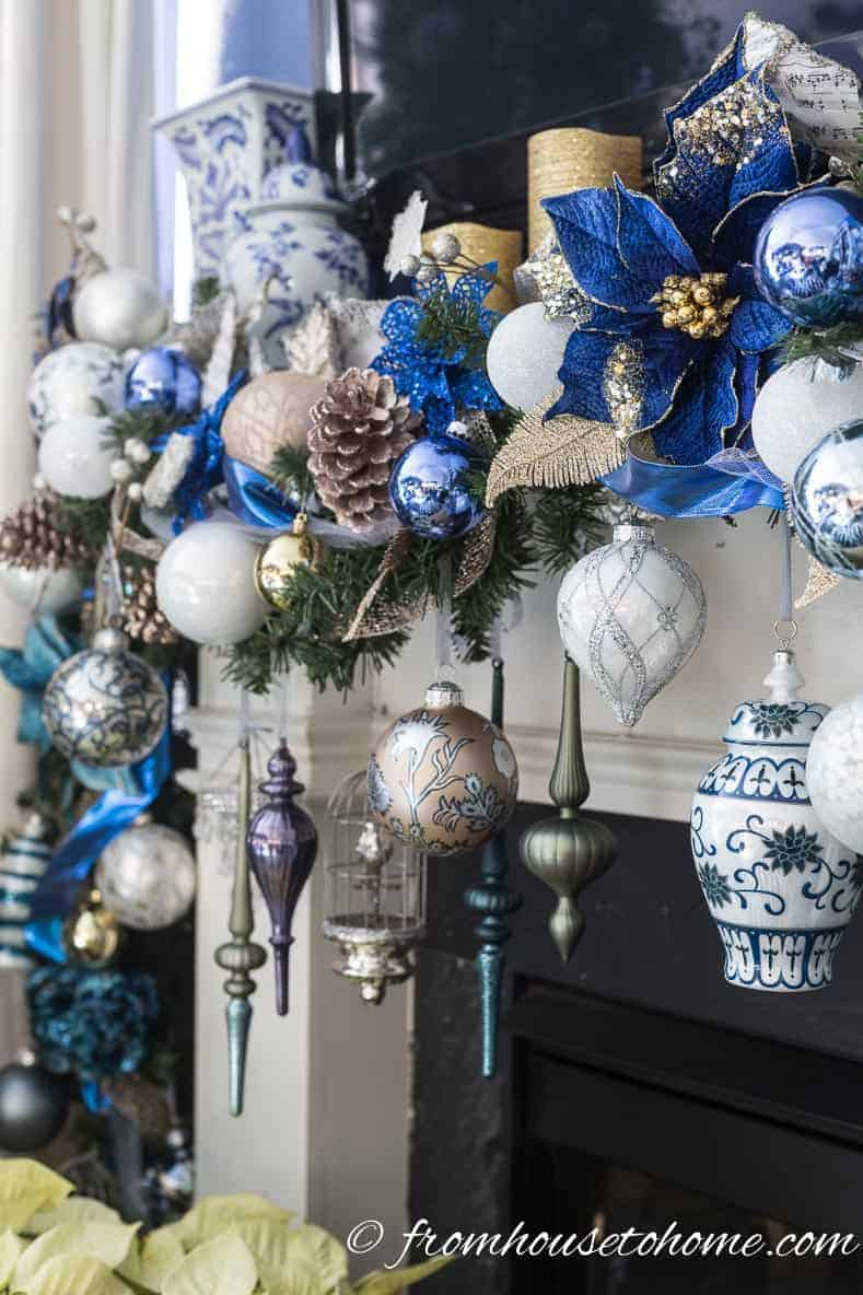 Adding other subtle colors of ornaments adds some extra interest to the garland | Blue and White Christmas Home Decorating Ideas