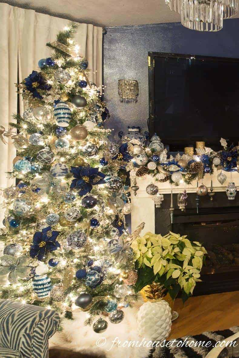 The tree is an extension of the garland on the mantel | Blue and White Christmas Home Decorating Ideas