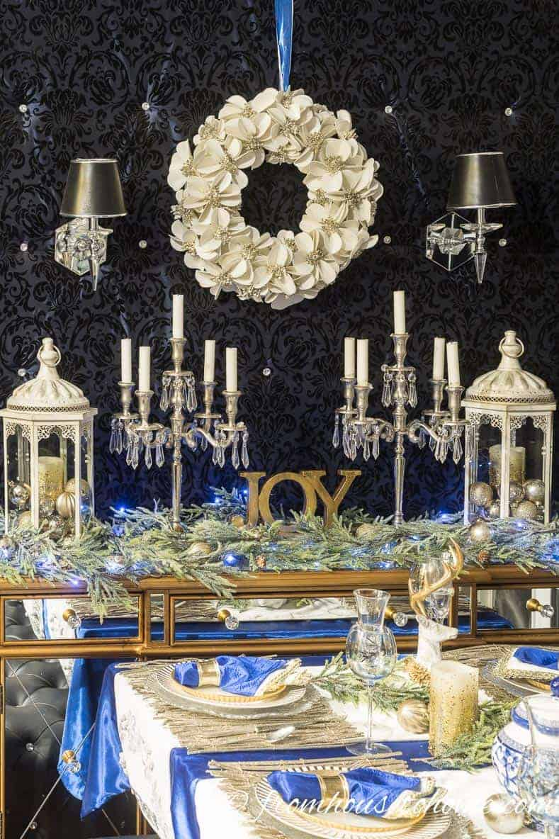 Christmas wreath as dining area backdrop | Blue and White Christmas Home Decorating Ideas