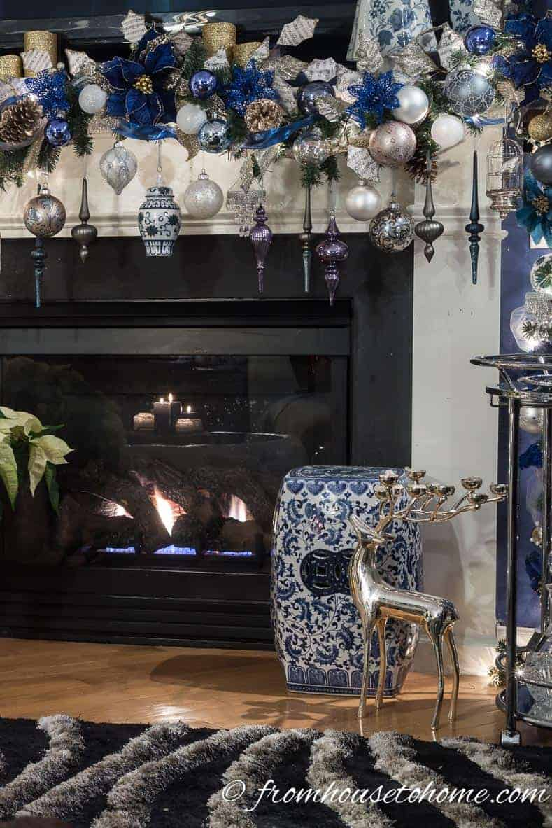 The Christmas garland over the fireplace | Blue and White Christmas Home Decorating Ideas