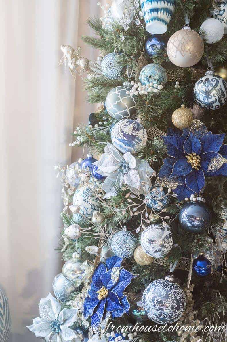 Blue and white Christmas ornaments on the tree | 40 Stunning Ways to Decorate a Christmas Tree