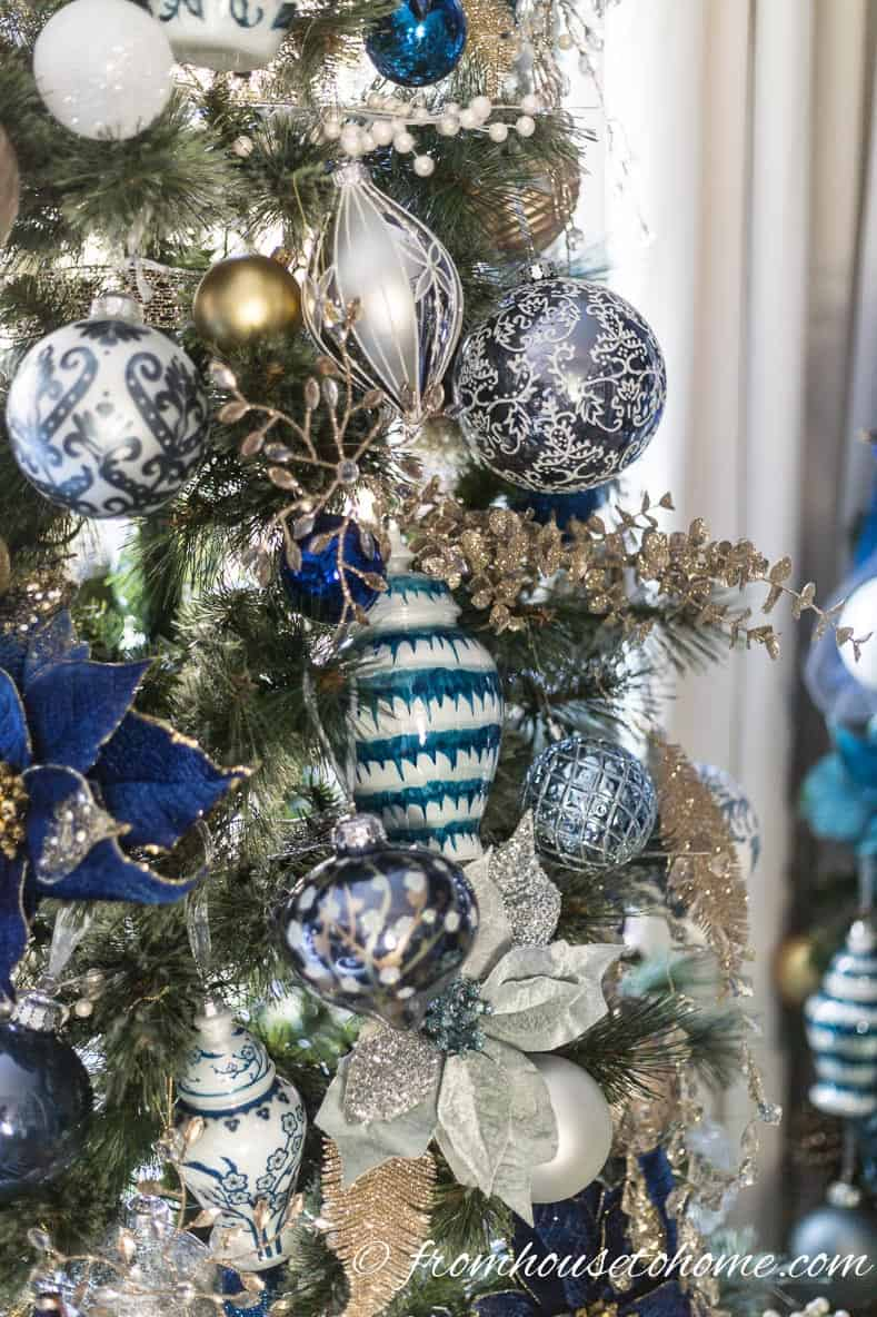 Blue and white ginger jar Christmas ornaments on the tree | 40 Stunning Ways to Decorate a Christmas Tree