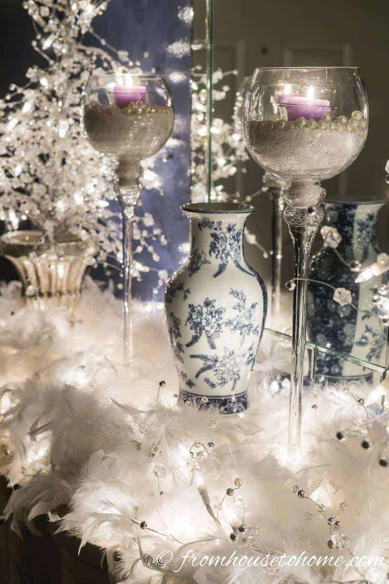 The feathers almost look like snow in the lights | Blue and white Christmas home decorating ideas