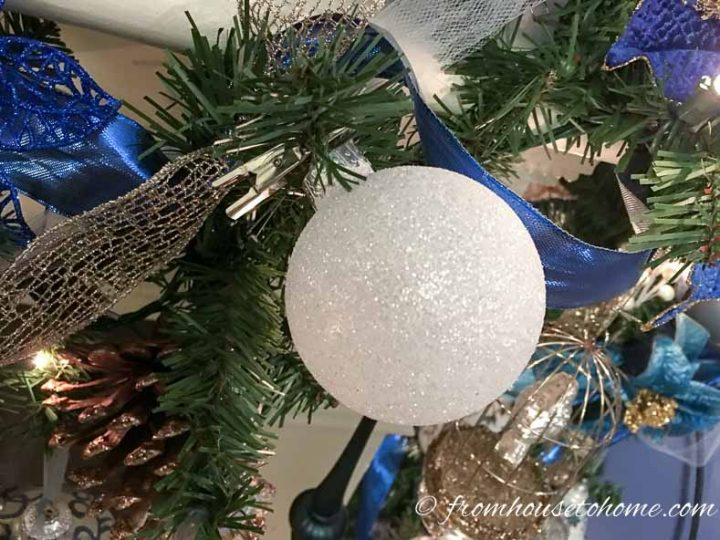 White ornament hung on the garland with an alligator clip