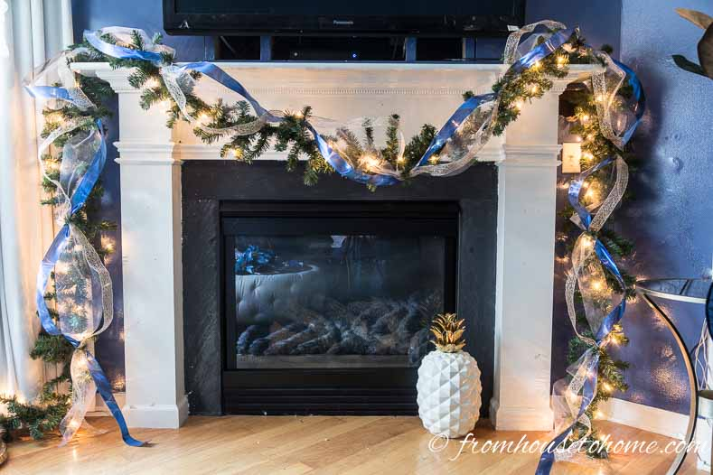 Continue attaching the ribbon to the end of the garland | How to make a Christmas garland