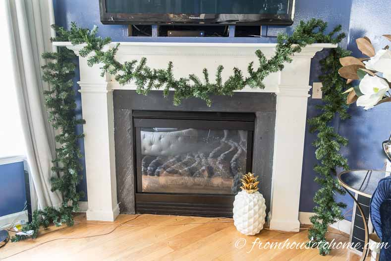 Make sure that the garland is hanging the way you want it | How To Make A Christmas Garland