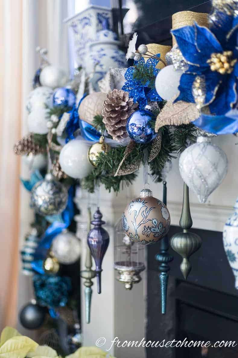 Ornaments hanging in front of the fireplace | How to make a Christmas garland