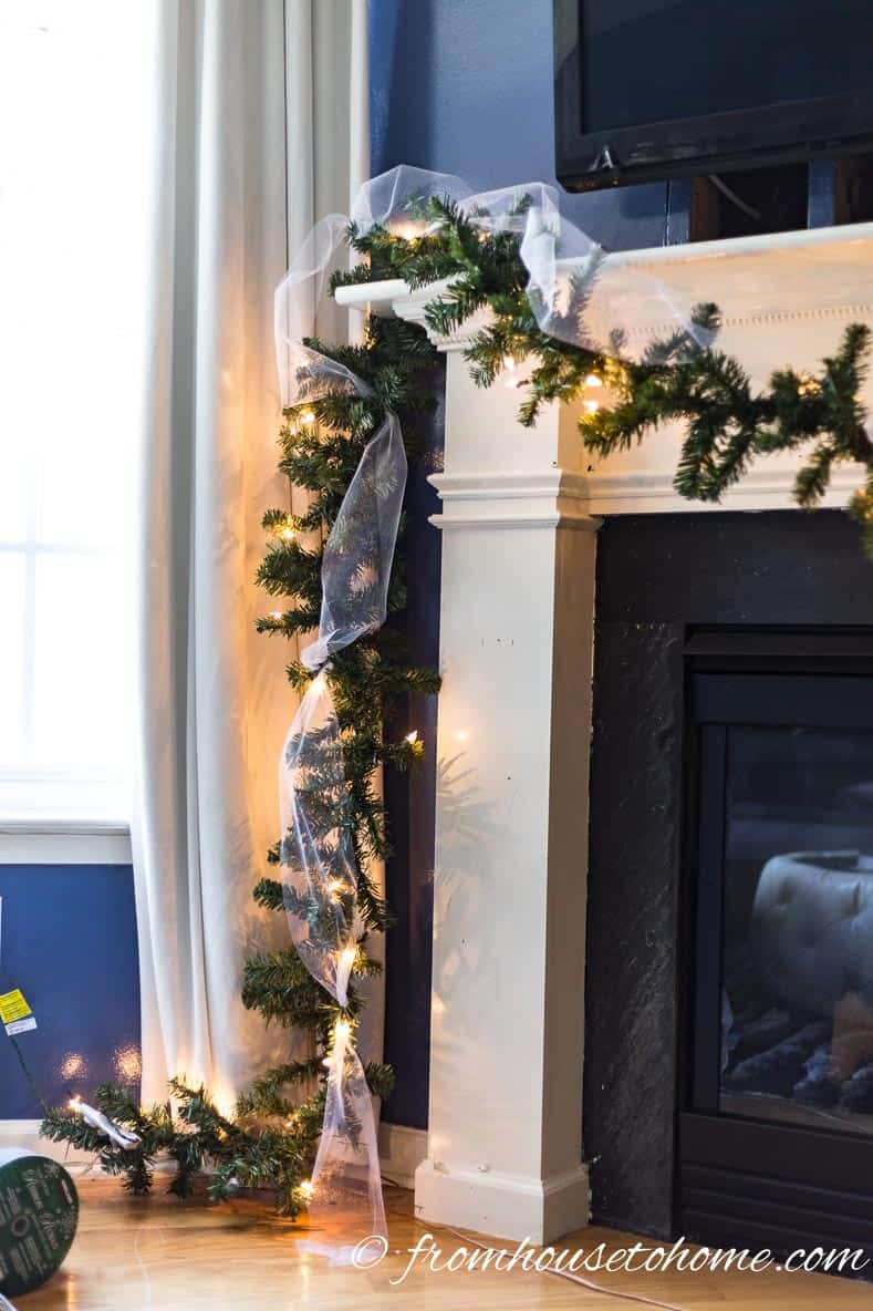 Attach the tulle in 2 or 3 places going up the garland on the side of the fireplace | How to make a Christmas garland