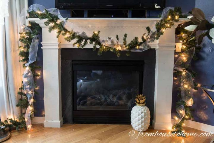 Garland and tulle over the fireplace mantel