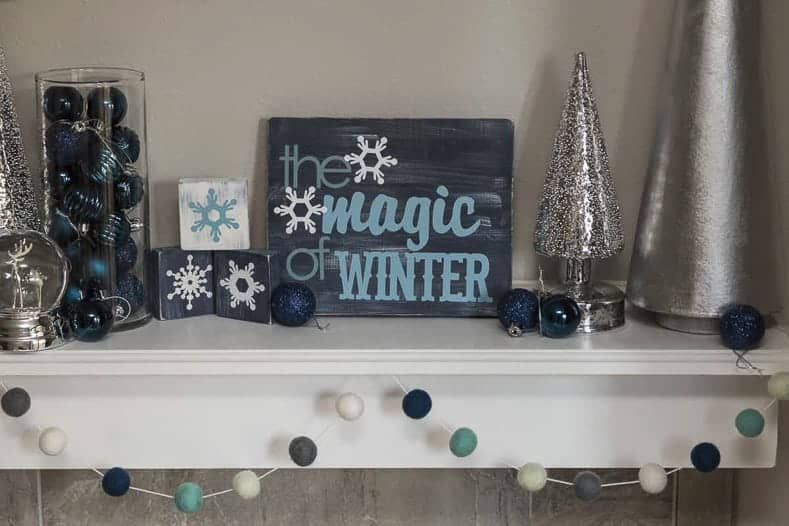 """Magic of Winter"" sign made with a Cricut machine"