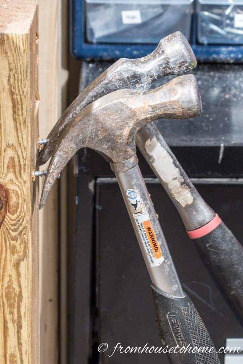 Hang hammers on screws for easy access