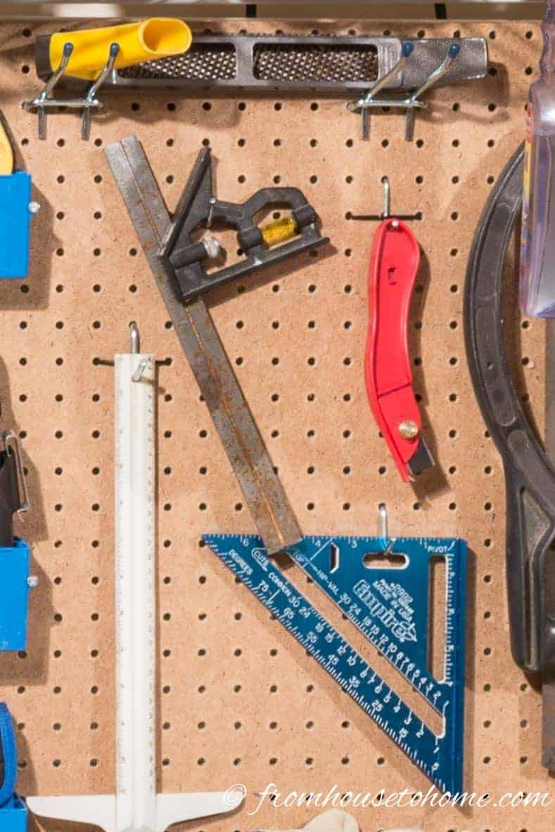 Pegboard with tools hung on it
