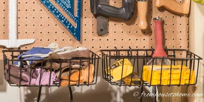 Baskets hung on a pegboard for tool storage