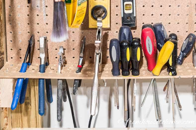 Use a pegboard shelf for storing screwdrivers and plier