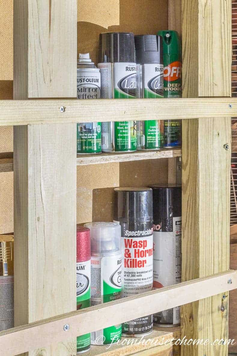 Nail a small board across the front to keep the cans from falling over