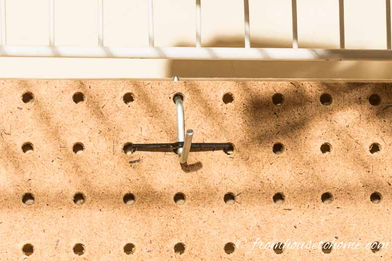 Use pegboard hooks with tie downs