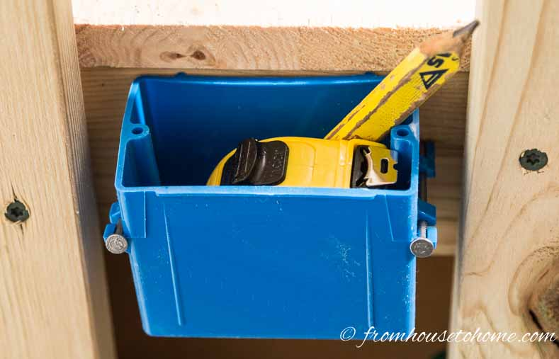 Use electrical boxes as storage for tape measures and pencils