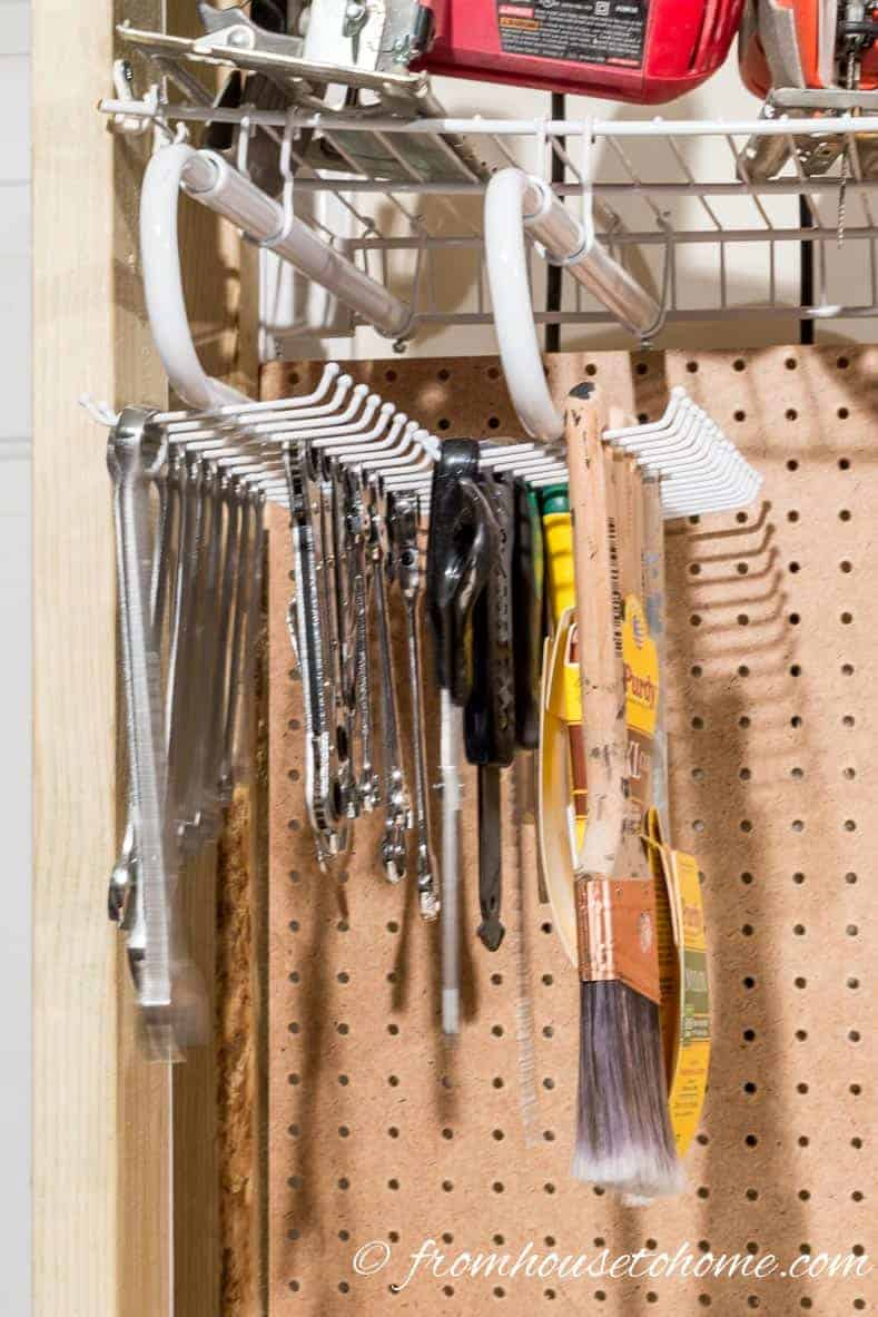 Hang pull out tie racks in the garage for tool storage
