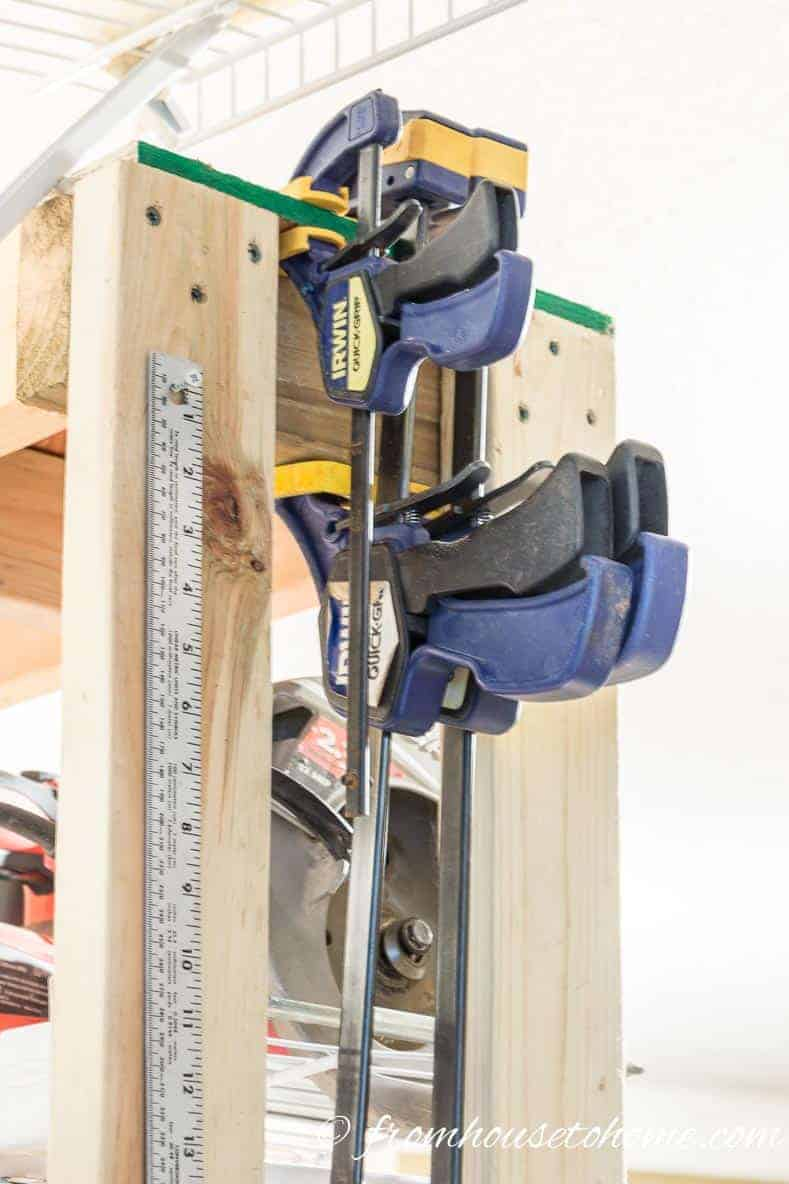 Store clamps on the side of a shelf or a block of wood