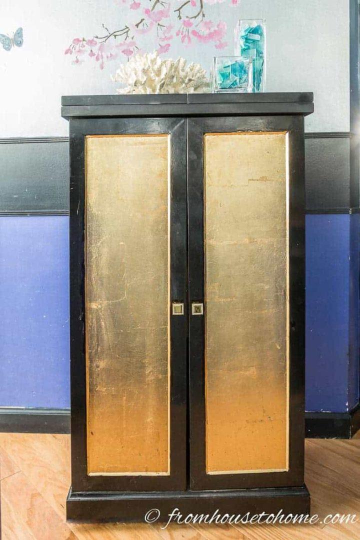 DIY bar cabinet with gold leaf doors