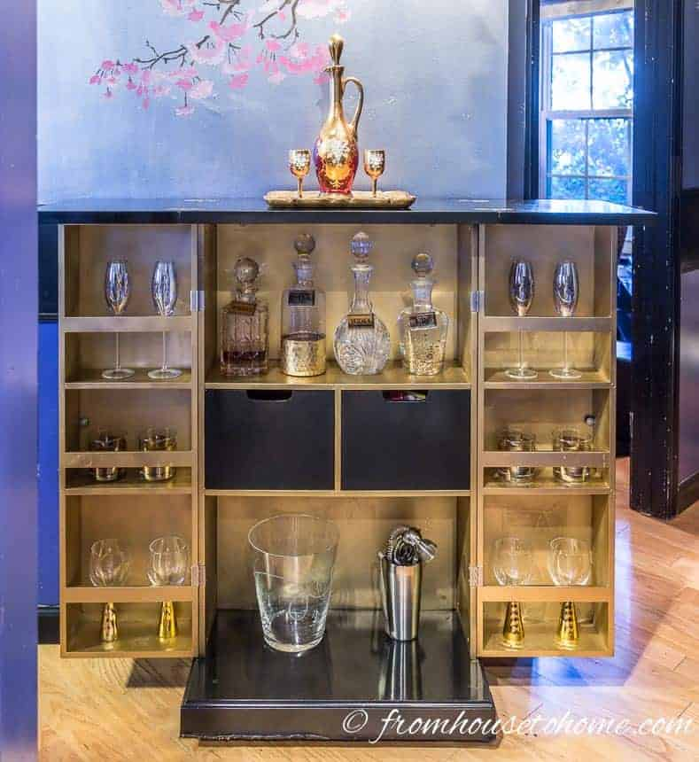 Black and gold bar cabinet