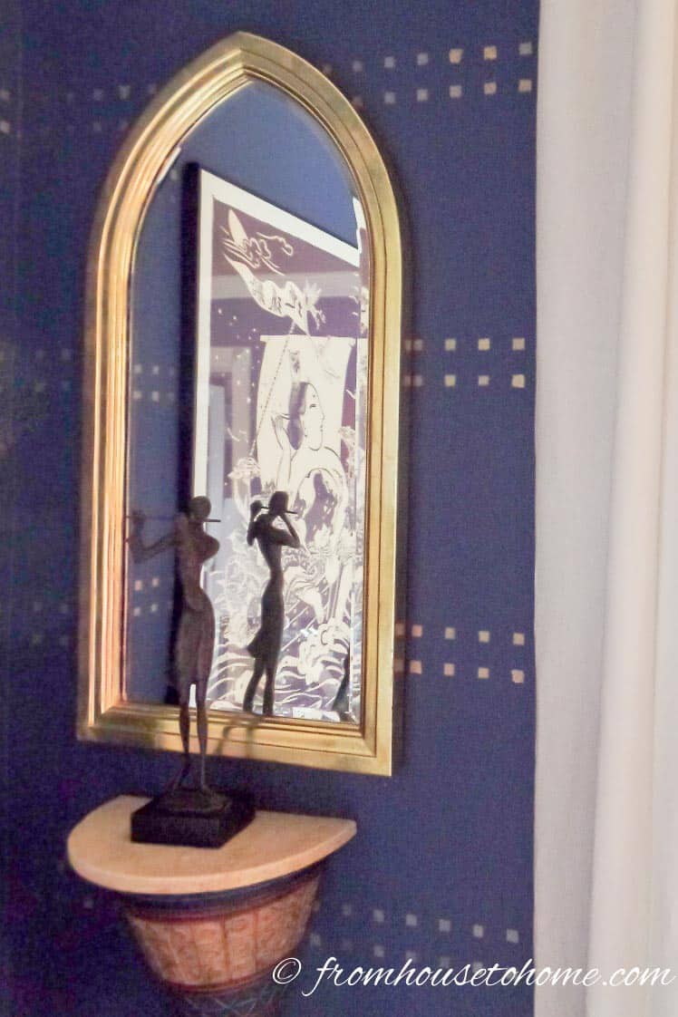 Gold leaf frame on a mirror in a contemporary glam living room