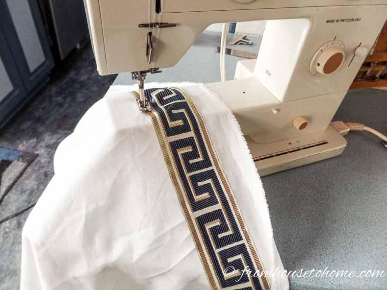 Sew trim around the curtain edges