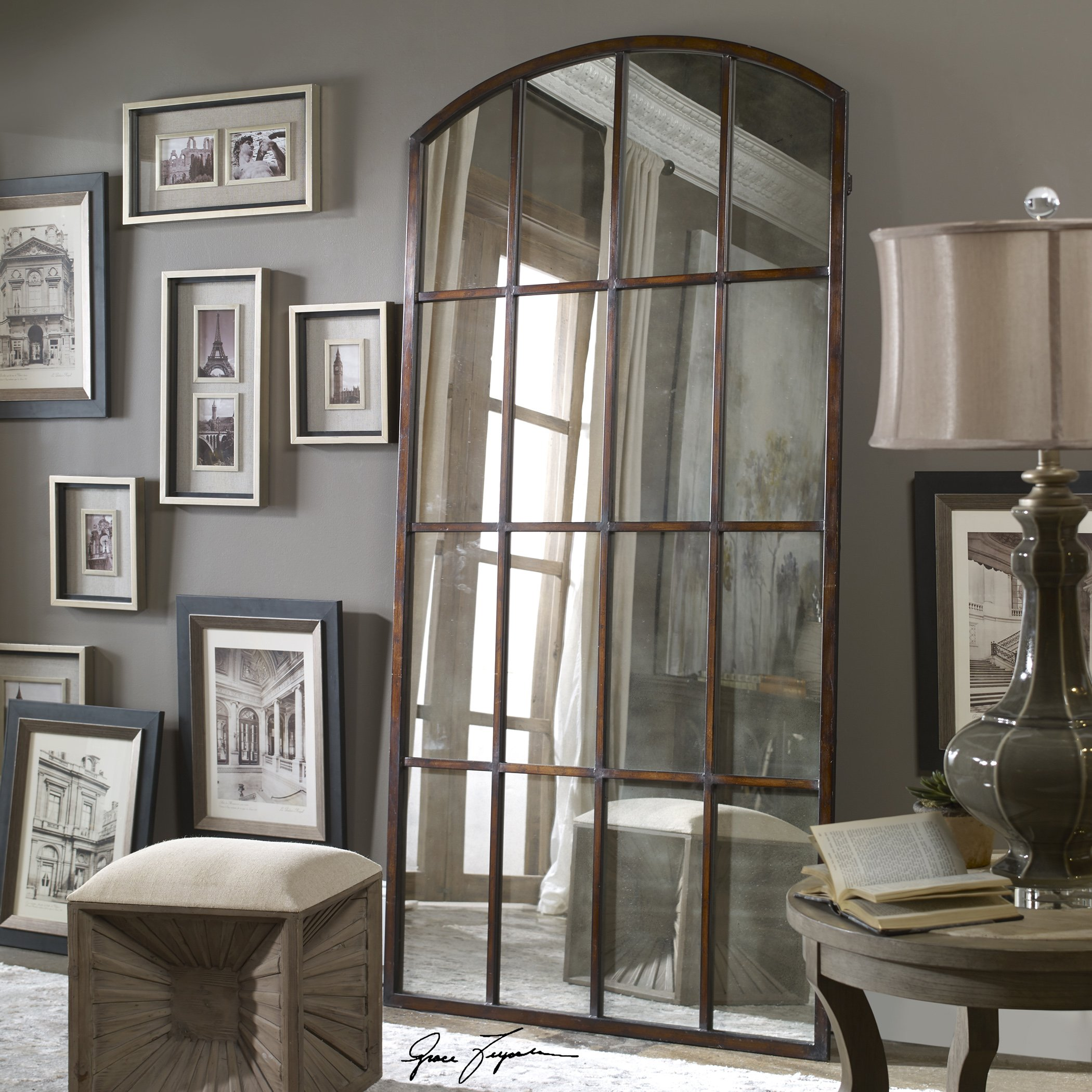 Antique-style mirror leaning against a living room wall