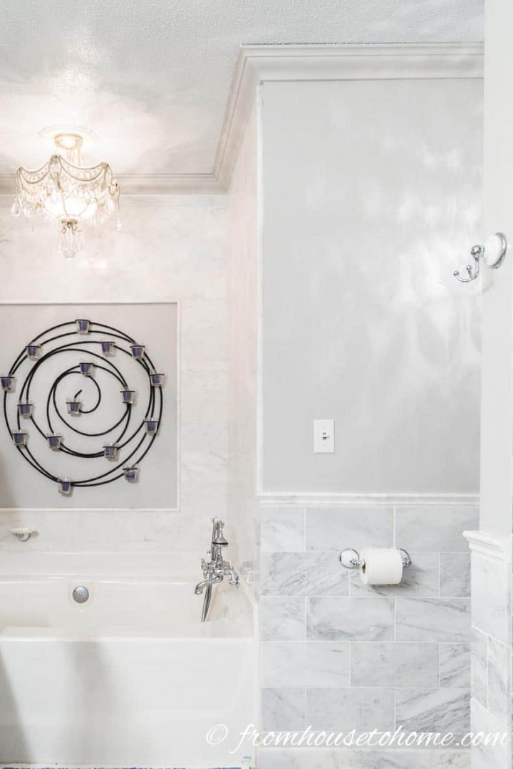 Master bathroom with low ceiling that has all of the walls and ceiling painted in gray