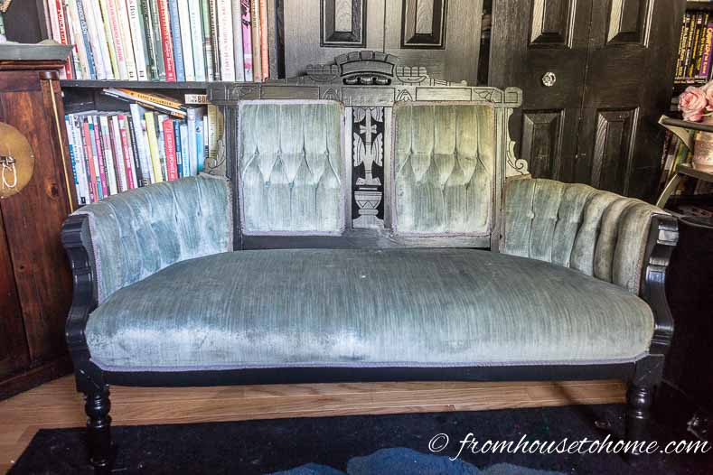 Settee with woodwork painted black