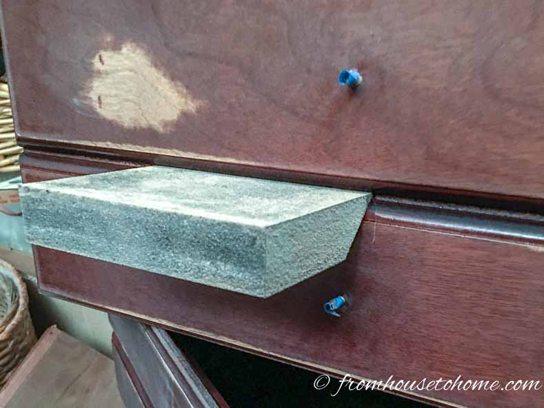 A foam sanding block works well for sanding crevices in furniture