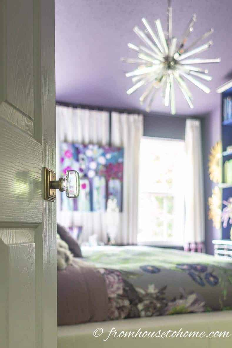Purple Master bedroom makeover with glass door knobs
