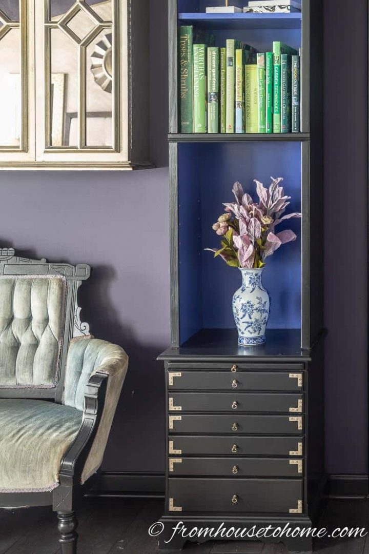 Painted book shelves and settee in a bedroom