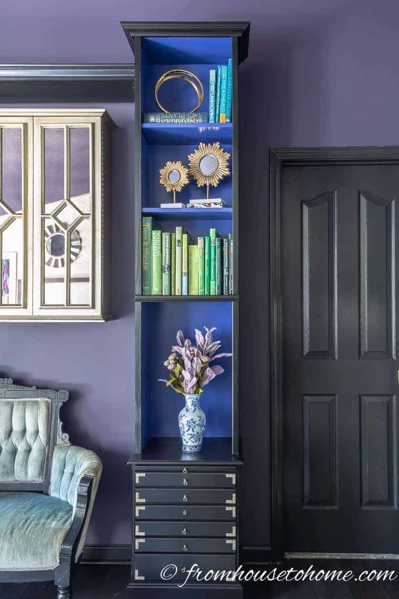 Blue and green add some extra color to the purple bedroom walls