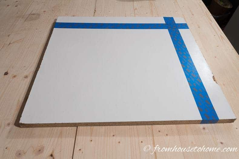 Tape the board where you will cut to prevent the edges from chipping