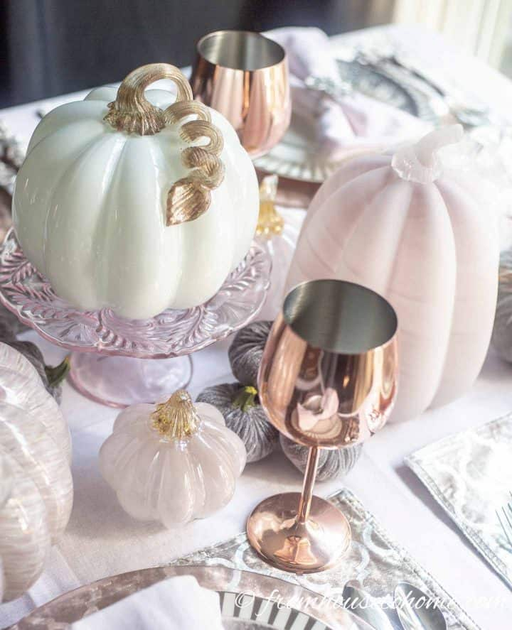 Pink and white glass pumpkins as fall home decor
