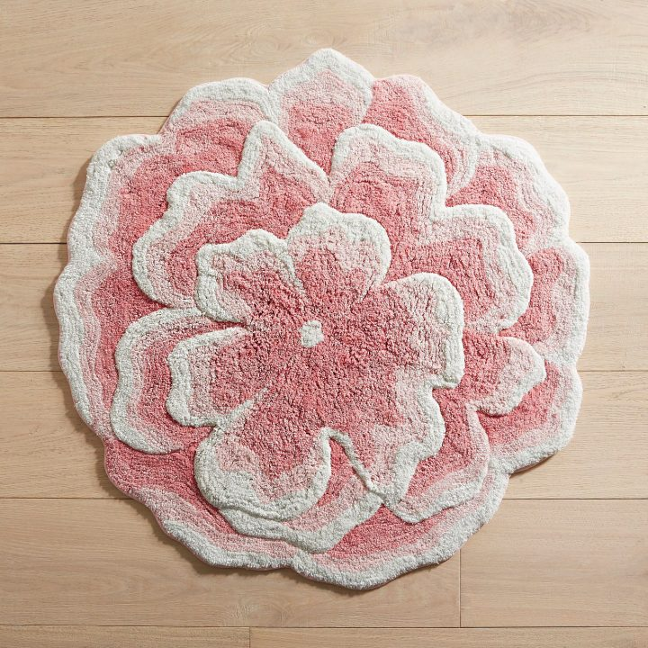 Coral-colored floral bath mat