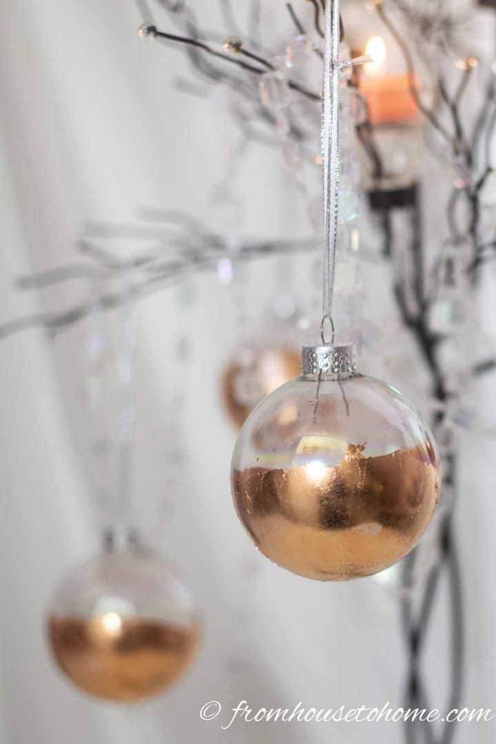 DIY copper Christmas decorations hanging from a candle tree