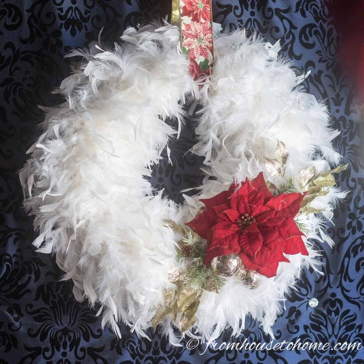 DIY white feather Christmas wreath with red poinsettia