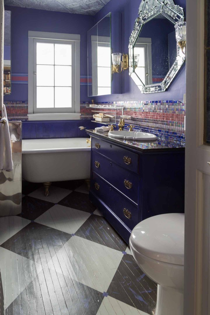 Painted floor tiles on wood bathroom floor